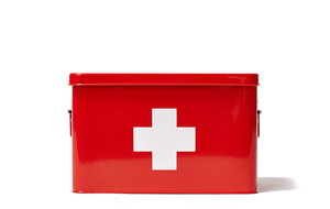 First aid kit in a red box with a white cross